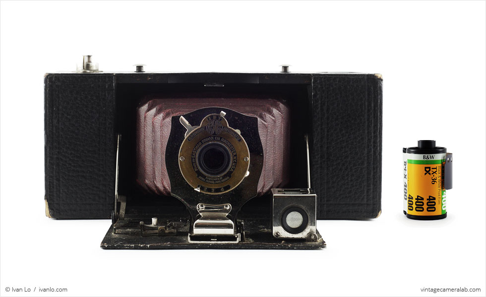 Kodak No. 2A Folding Pocket Brownie (with 35mm cassette for scale)