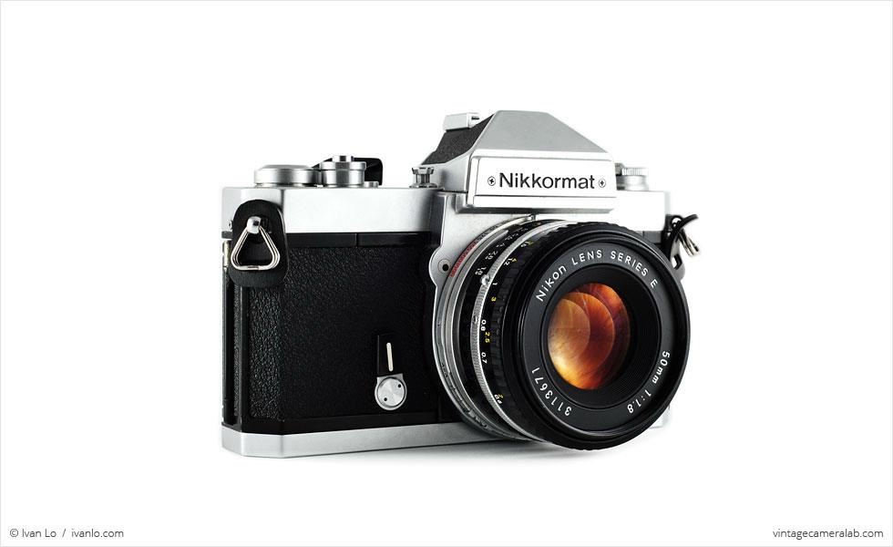 Nikon Nikkormat FT3 (three quarters, with Nikkor 50mm f/1.8 lens)