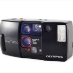 Olympus Infinity Twin (three quarters, open)