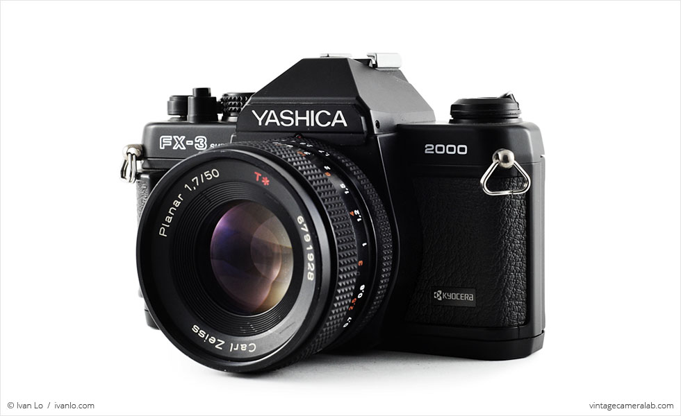Yashica FX-3 Super 2000 (three quarters, with Carl Zeiss Planar T* 50mm f/1.7)