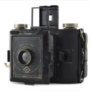 Agfa PD16 Clipper (three quarters, lens extended, viewfinder up)