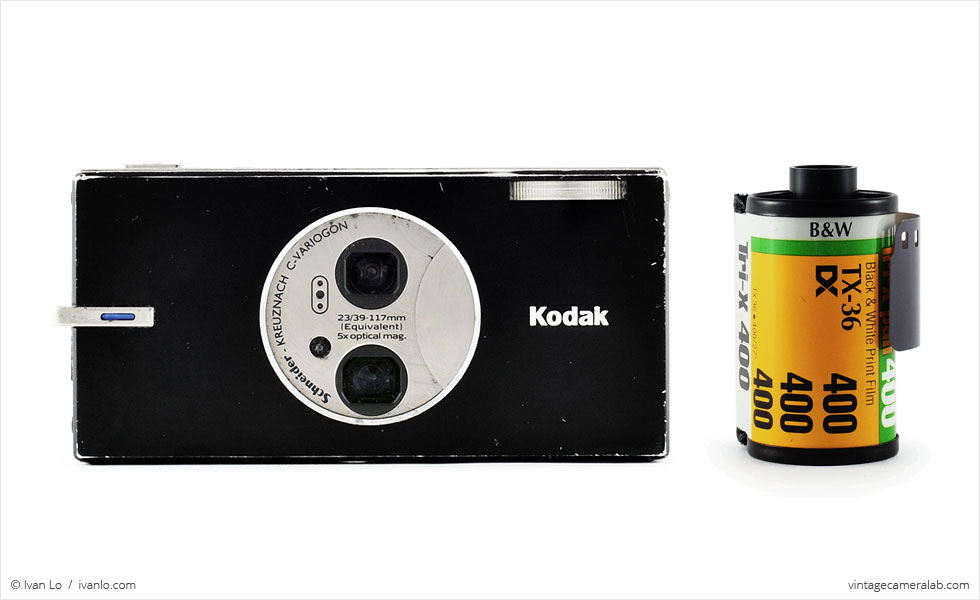 Kodak EasyShare V570 (with 35mm cassette for scale)