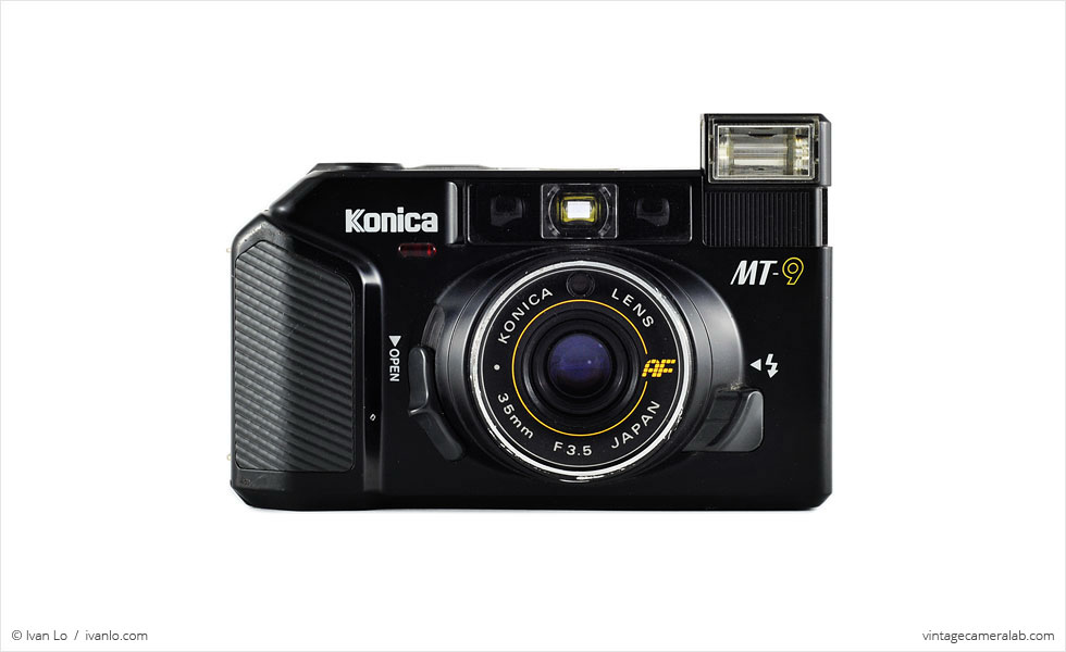 Konica MT-9 (front view, lens open, flash activated)