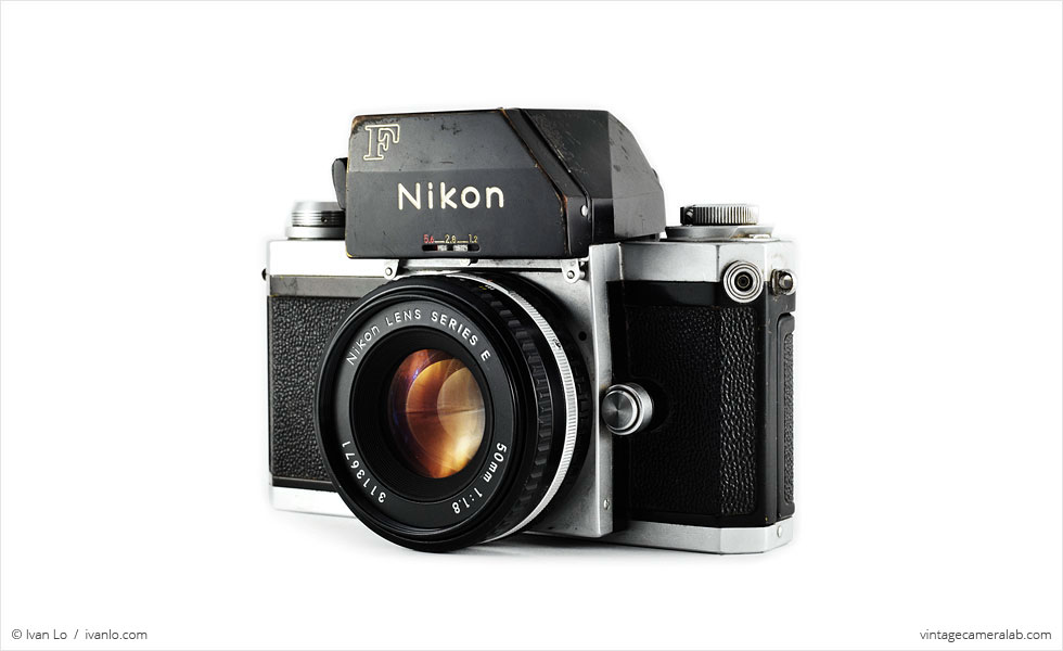 Nikon F (three quarters, with Nikkor 50mm f/1.8 lens)