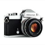 Nikon Nikkormat FT3 (three quarters, with Nikkor 50mm f/1.8 lens)